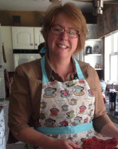 Cindy wearing apron in the kitching
